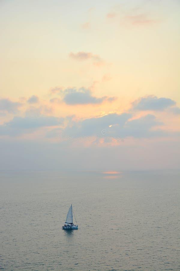 Sailboat under sunset royalty free stock photo