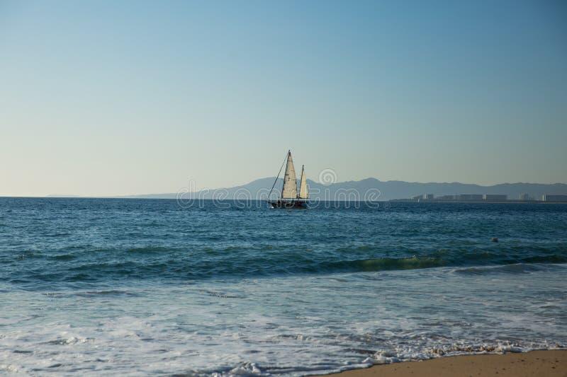 Sailboat view from Camarones Beach. Sailboat on Banderas Bay from Camarones Beach, Puerto Vallarta, Jalisco, Mexico stock images