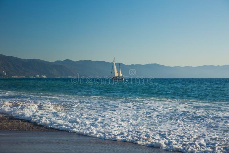 Sailboat view from Camarones Beach. Sailboat on Banderas Bay from Camarones Beach, Puerto Vallarta, Jalisco, Mexico royalty free stock photography