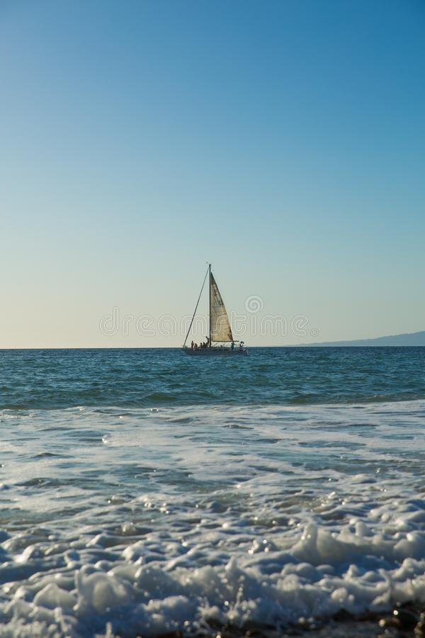 Sailboat view from Camarones Beach. Sailboat on Banderas Bay from Camarones Beach, Puerto Vallarta, Jalisco, Mexico stock photography