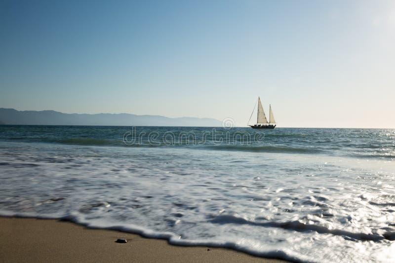 Sailboat view from Camarones Beach. Sailing Banderas Bay from Camarones Beach, Puerto Vallarta, Jalisco, Mexico stock image