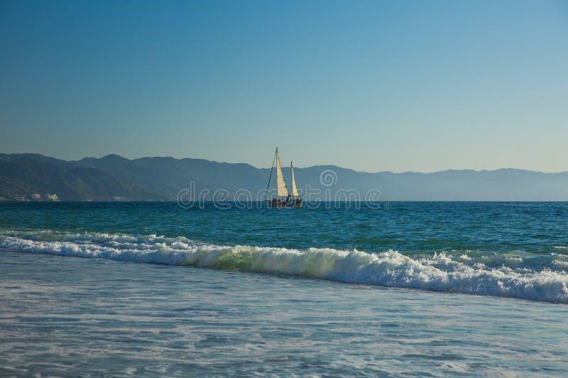 Sailboat view from Camarones Beach. Sailing Banderas Bay from Camarones Beach, Puerto Vallarta, Jalisco, Mexico royalty free stock photos