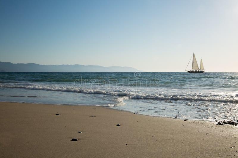 Sailboat view from Camarones Beach. Sailing Banderas Bay from Camarones Beach, Puerto Vallarta, Jalisco, Mexico royalty free stock photo