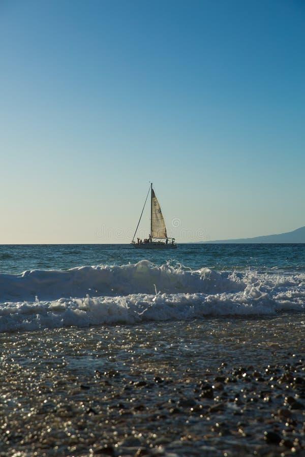 Sailboat view from Camarones Beach. Sailing Banderas Bay from Camarones Beach, Puerto Vallarta, Jalisco, Mexico stock photo