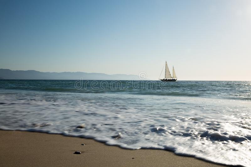 Sailboat view from Camarones Beach. Sailing Banderas Bay from Camarones Beach, Puerto Vallarta, Jalisco, Mexico royalty free stock images