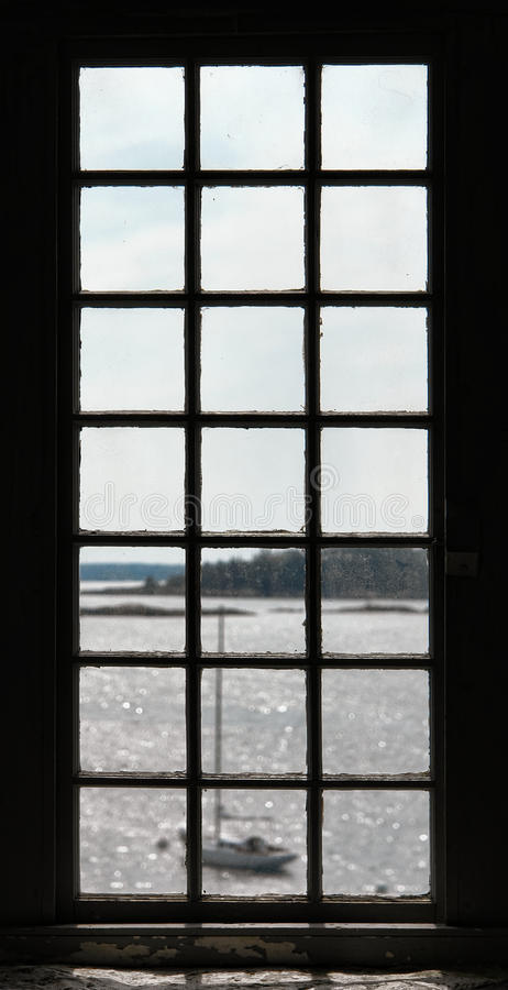 Sailboat and Water View Through an Old Window royalty free stock image