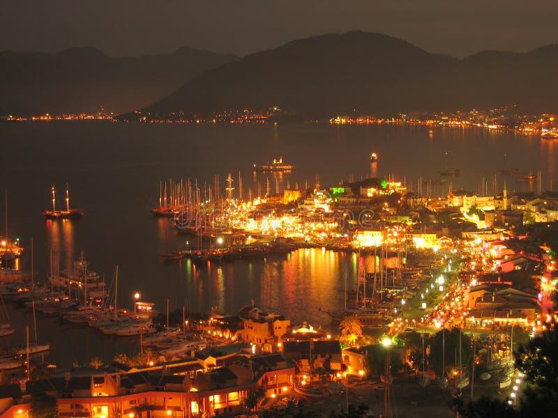 Sailboats anchored in harbor night scene stock image