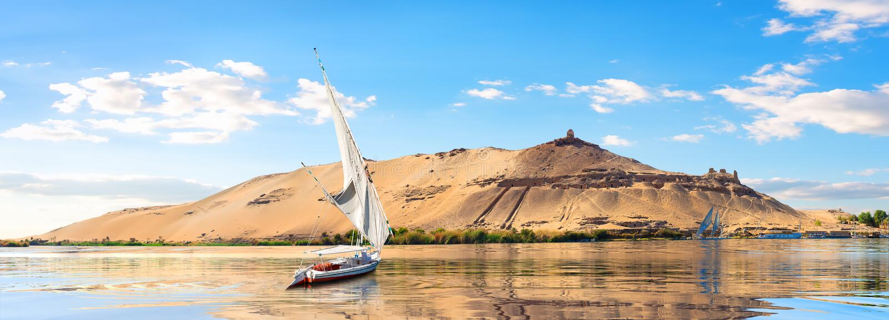 Sailboats in Aswan. River Nile and boats at sunset in Aswan royalty free stock photo