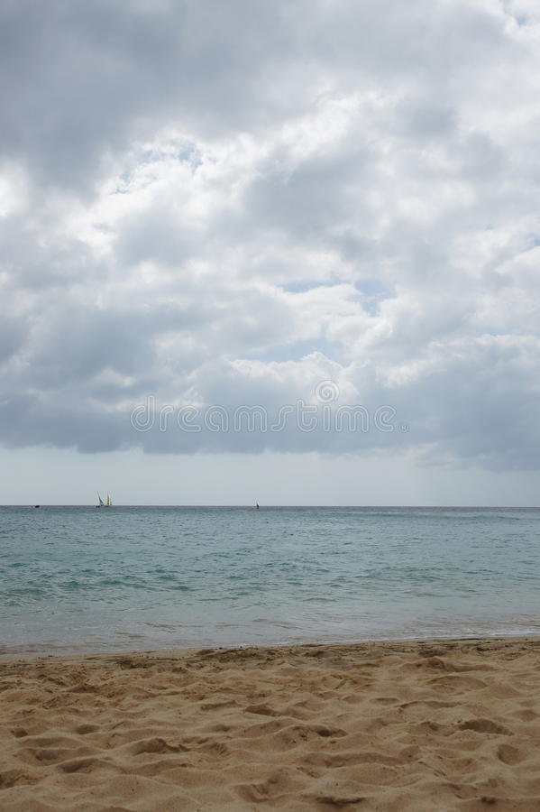 Sailboats on the Atlantic. Beach with sailing and surfing on the Atlantic Ocean royalty free stock photo