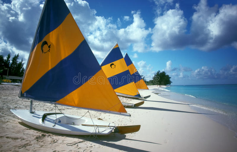 Sailboats Cayman Island Beach. Sailboats line a part of seven-mile beach on Grand Cayman Island. Seven Mile Beach (SMB) is a long crescent of coral-sand beach on stock photography