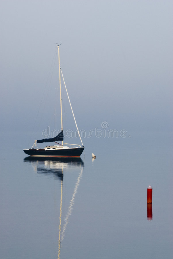 Sailboats at dawn. On a foggy morning in door county wisconsin. summer 2007 stock photography
