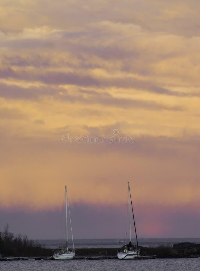 Sailboats at dusk stock image
