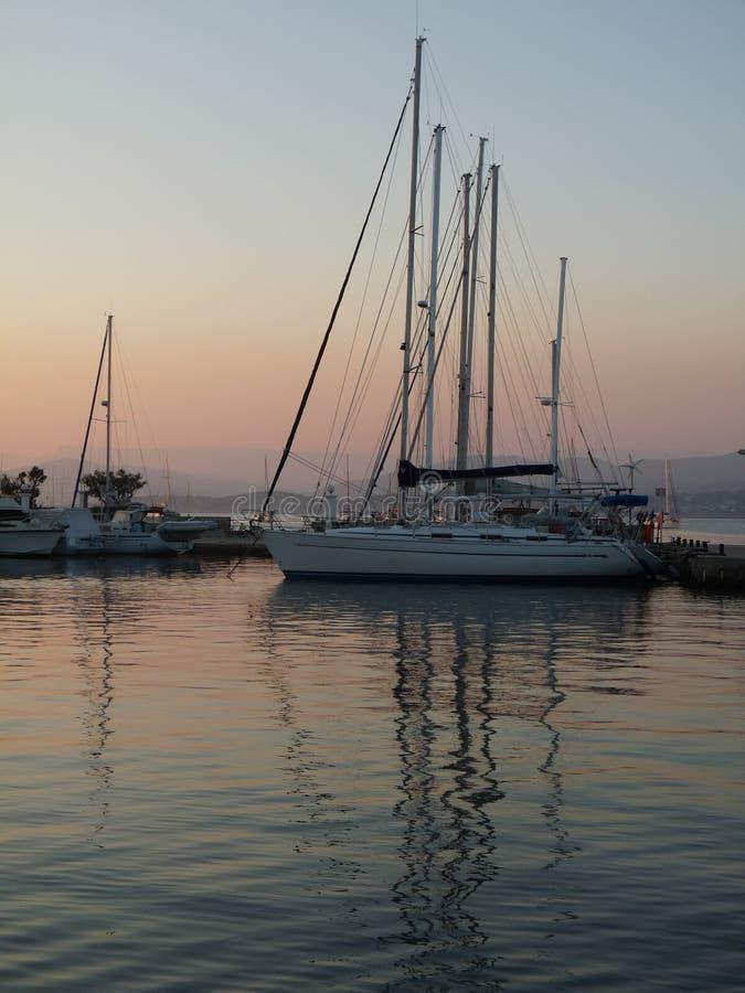 Sailboats at dusk royalty free stock images