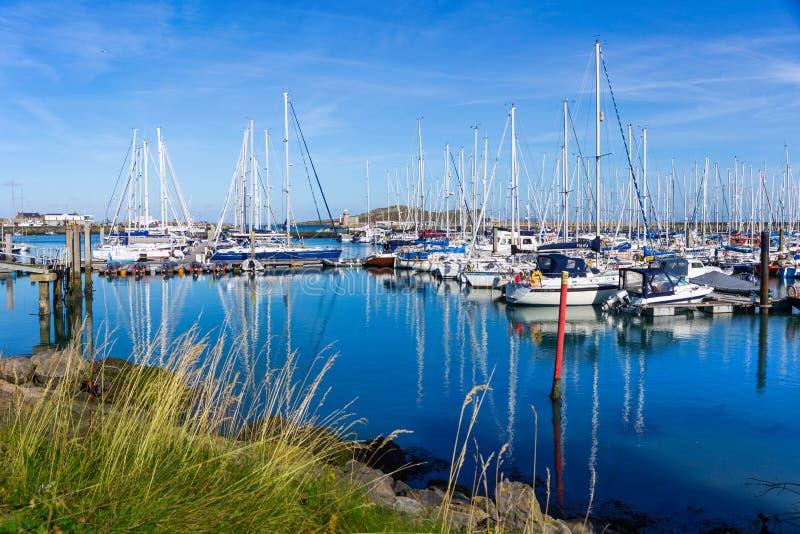 Sailboats in the harbor of Howth near Dublin stock photos