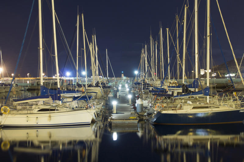 Sailboats in the harbor at night. Some sailboats in the harbor at night royalty free stock photos