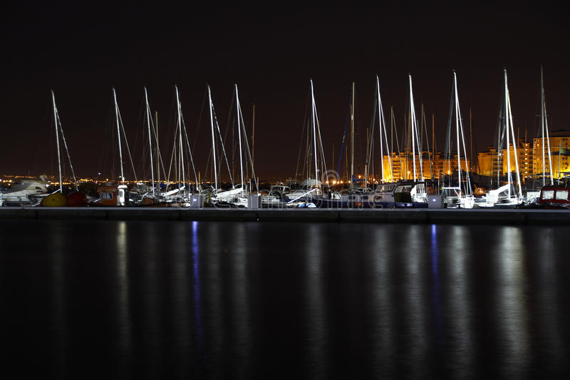 Sailboats in the harbor at night. Some sailboats in the harbor at night stock photos