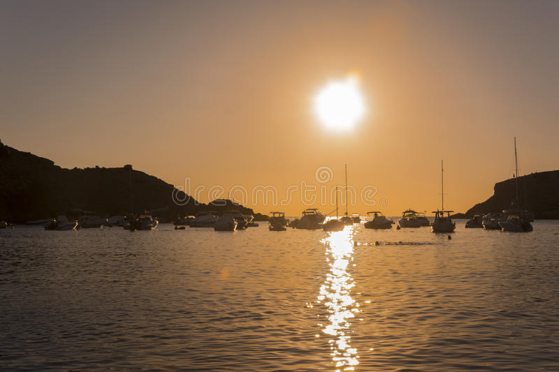 Sailboats in a harbor at sunset. Mediterranean sea of Ibiza island. Quiet scene: Sailboats in a harbor at sunset. Mediterranean sea of Ibiza island stock photography