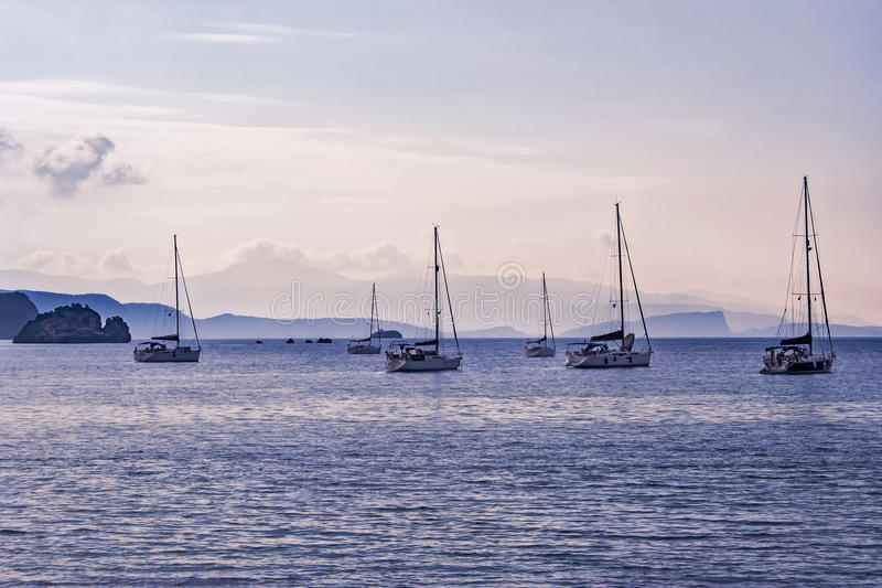 Sailboats in harbor at sunset. At Parga, in Greece royalty free stock photography