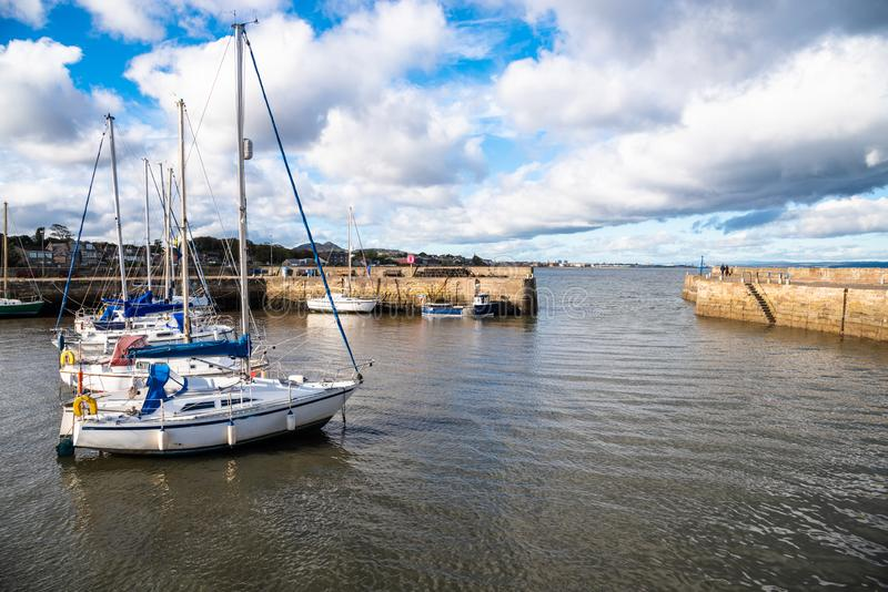 Sailboats in Harbour and Blue Sky with Clouds in Autumn royalty free stock images