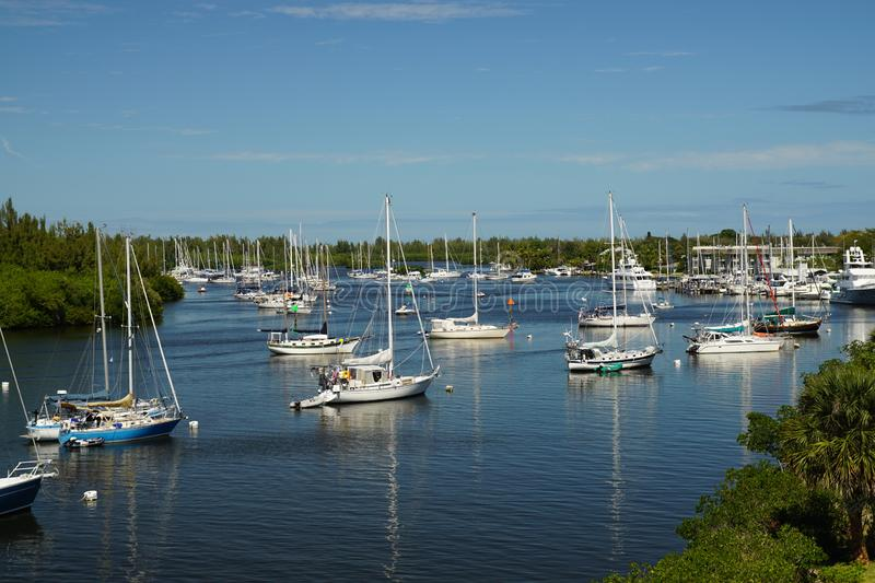 Sailboats on an inter coastal water way. Reflections in the water on a sunny summer day stock photography