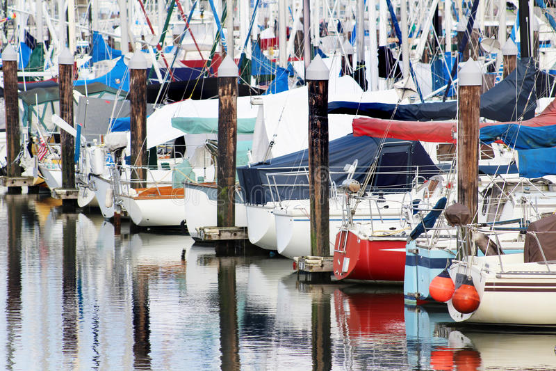 Sailboats in Moorage. Sailboats waiting in moorage separated by pilings stock photography