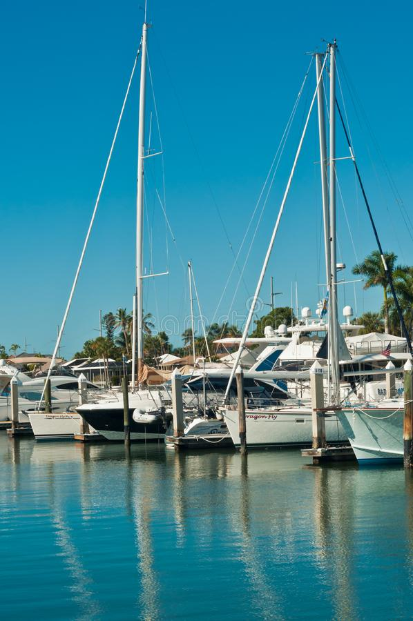 Sailboats moored in tropical harbor stock photo