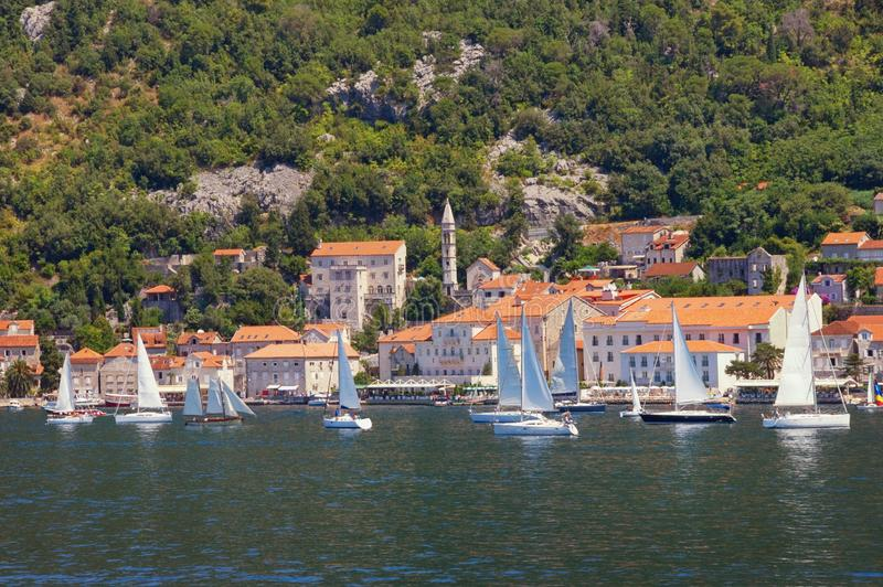 Sailboats near ancient town of Perast on sunny summer day. Montenegro, Bay of Kotor royalty free stock images