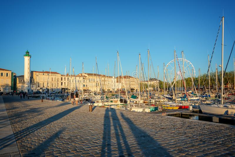 Sailboats in the old harbor of La Rochelle France at sunset stock image