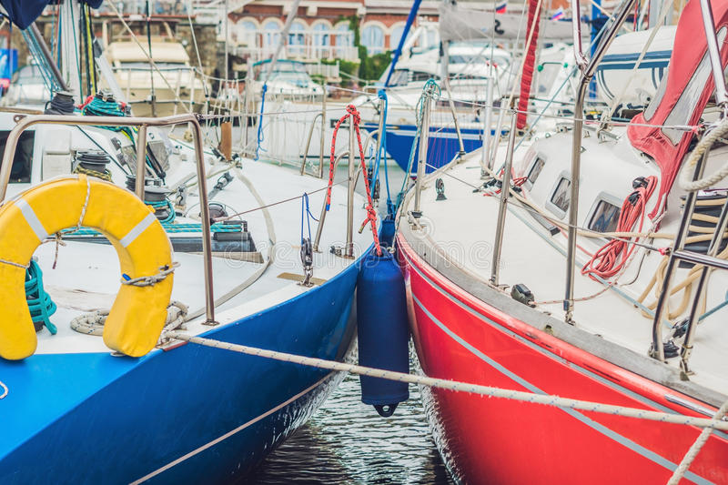 Sailboats on the pier in the yacht club royalty free stock photos