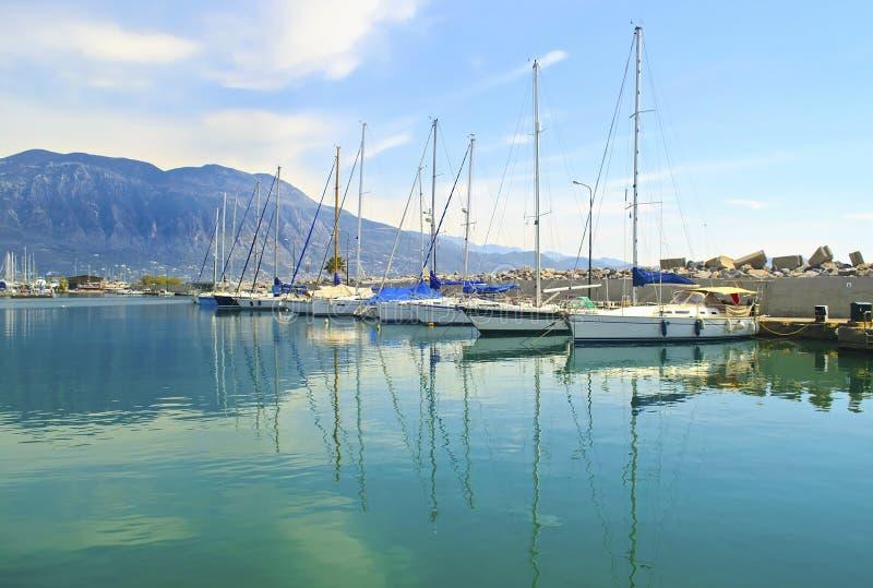 Sailboats reflected on sea at Kalamata Greece stock photo