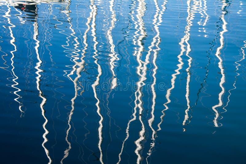 Sailboats reflexes on the marina royalty free stock image