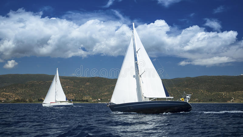 Sailboats in sailing regatta. Sailing. Yachting in cloudy weather. Luxury Yacht royalty free stock photos