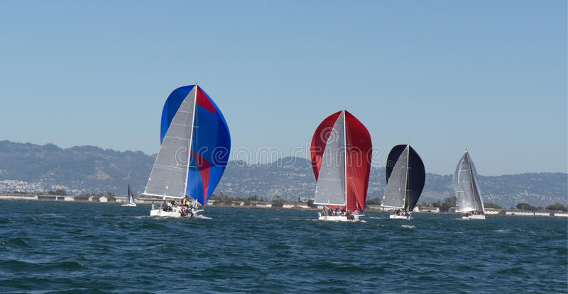 Sailboats with spinnakers at Rolex Cup. Sailboats with spinnakers competing at Rolex Cup sailing event in San Francisco September 2015 royalty free stock photo