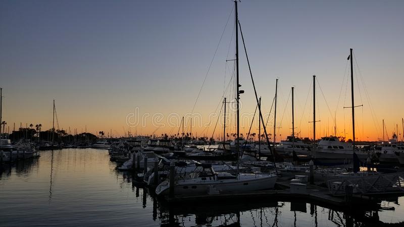 Sailboats Tethered at the Marina Dock at Sunset in San Diego California stock photo