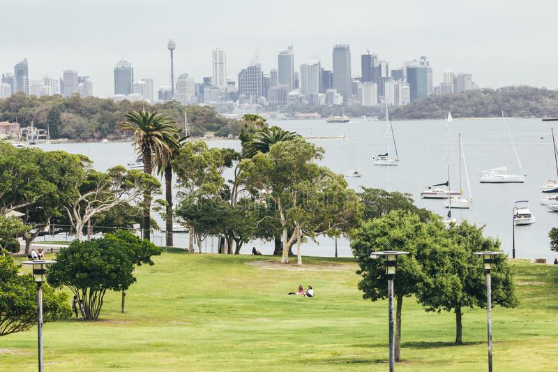 Sailboats and view of Sydney Australia. In background royalty free stock photo