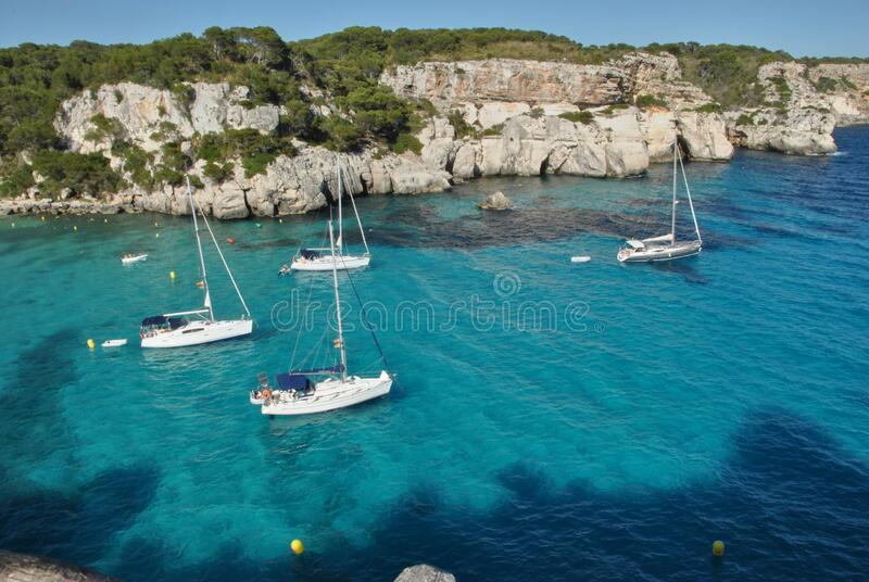 Sailboats waiting in the calm and blue sea. With boats royalty free stock images