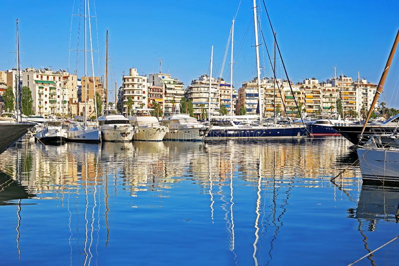 Sailboats and yachts reflected on sea at Pasalimani harbor Piraeus Greece. Water reflection of greek boats stock image