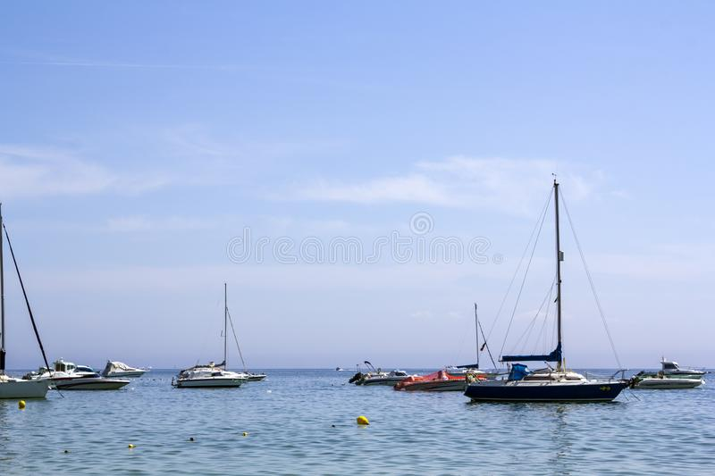 Sailboats and yachts in the sea royalty free stock photography