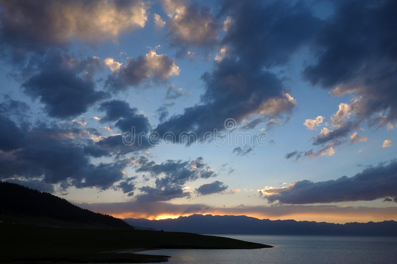 Sailimu lake at sunset. Lake at sunset, Sailimu lake, located in Xinjiang, China stock photography