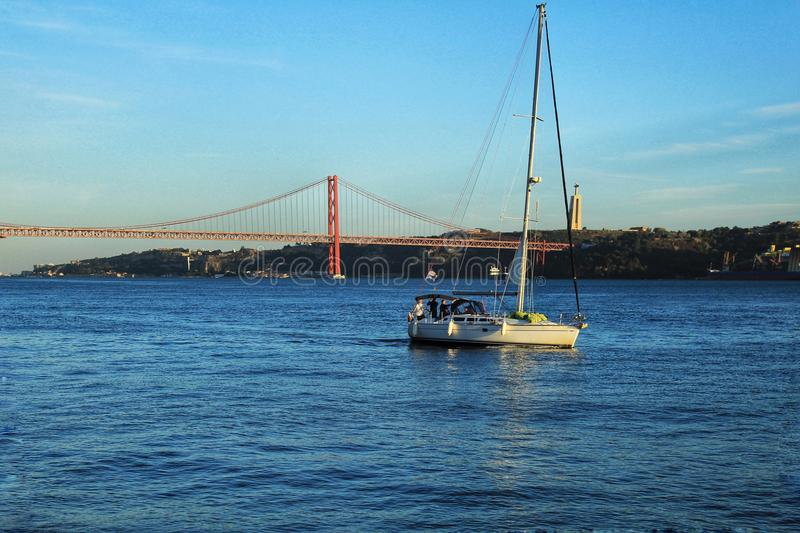 Sailing along the Tagus river in the afternoon stock photo