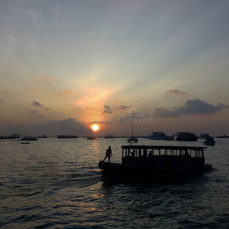 Sailing away. A boat sailing away from Hulhumale& x27;, maldives royalty free stock photo