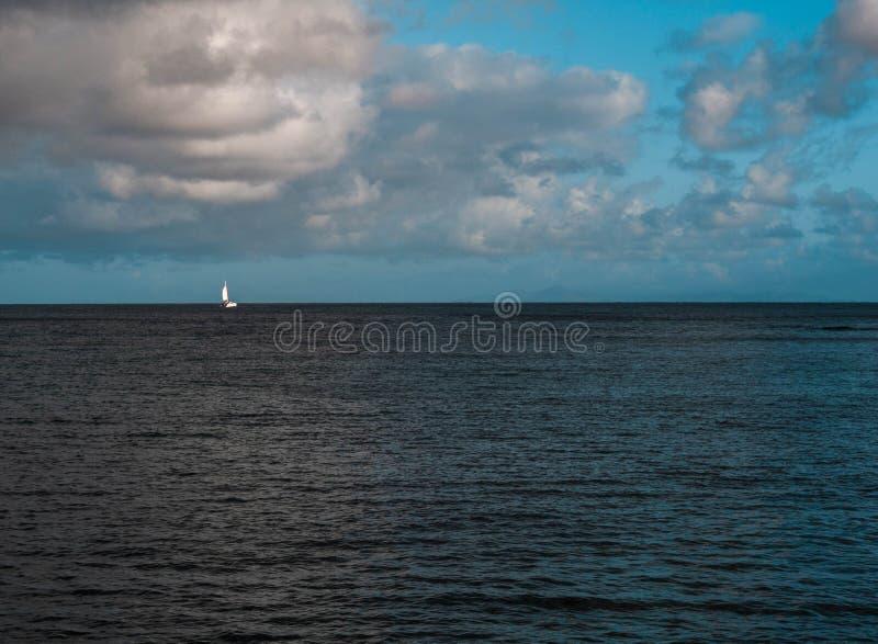 Sailing away into the sea. Sailing away into the Caribbean sea royalty free stock photography