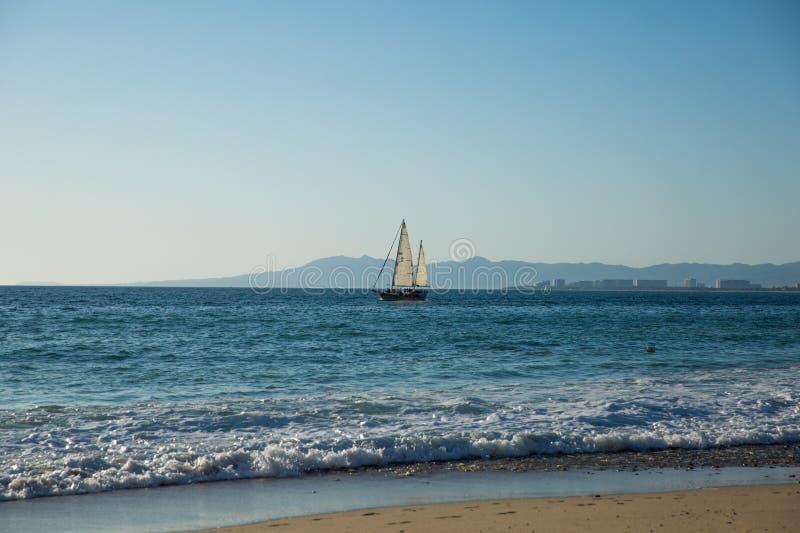 Sailboat view from Camarones Beach. Sailing Banderas Bay from Camarones Beach, Puerto Vallarta, Jalisco, Mexico royalty free stock image