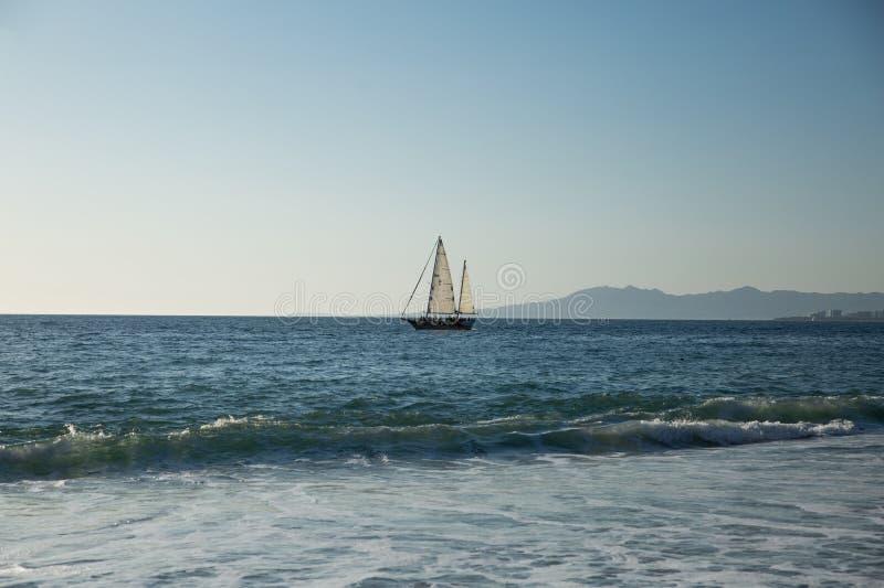 Sailboat view from Camarones Beach. Sailing Banderas Bay from Camarones Beach, Puerto Vallarta, Jalisco, Mexico stock photos