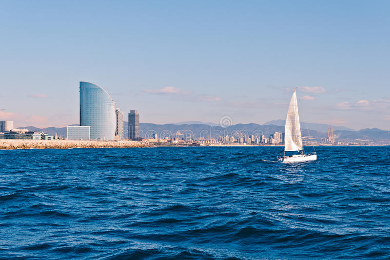 Sailing in Barcelona. With the city in the background stock image