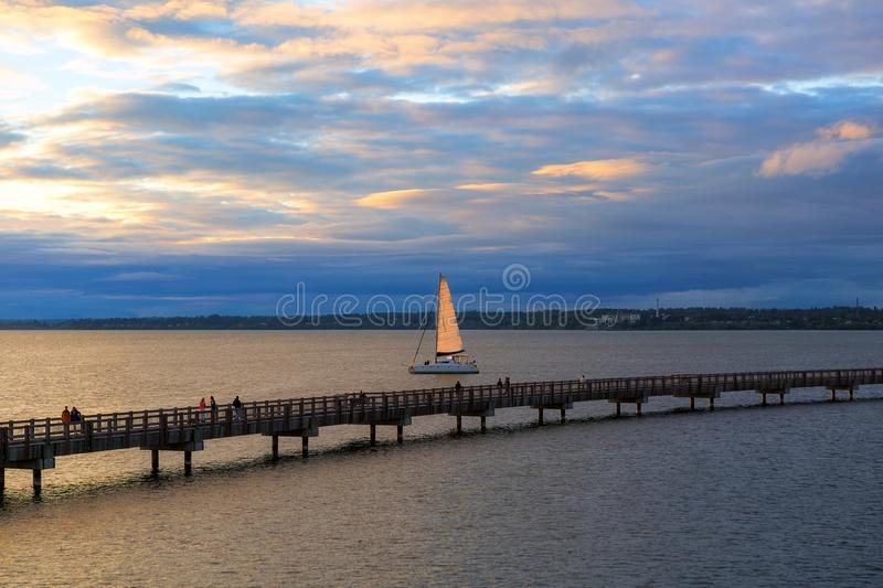 Sailing on Bellingham Bay during Sunset in Washington state. Sailing on Bellingham Bay by boardwalk at Boulevard Park in Bellingham Washington State during royalty free stock photography