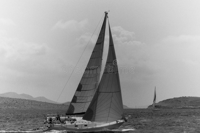Sailing Boat. Black & White sail boat with strong wing - Croazia 2007 stock image
