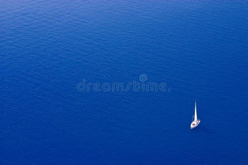Sailing Boat. White sailing boat against a pure blue mediterranean sea, near Santorini