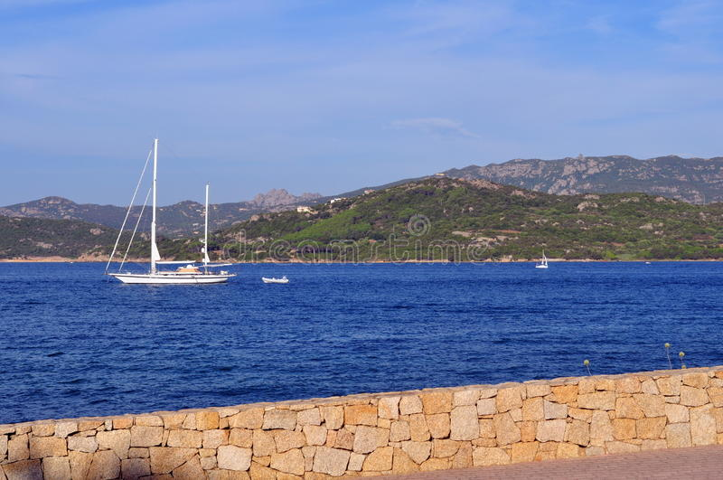 Sailing boat in the bay royalty free stock image