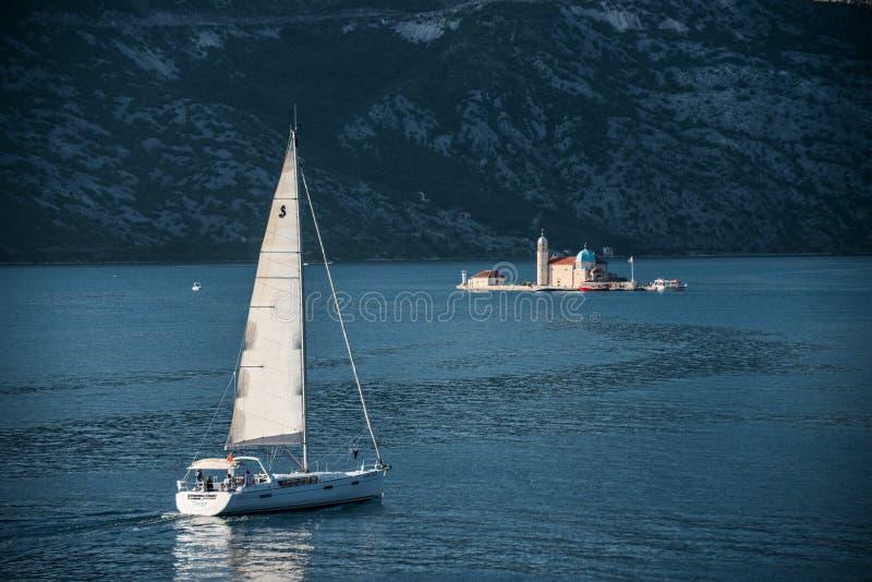 Sail Boat and The small islands of Ostrvo and Sveti Juraj monastery royalty free stock photos